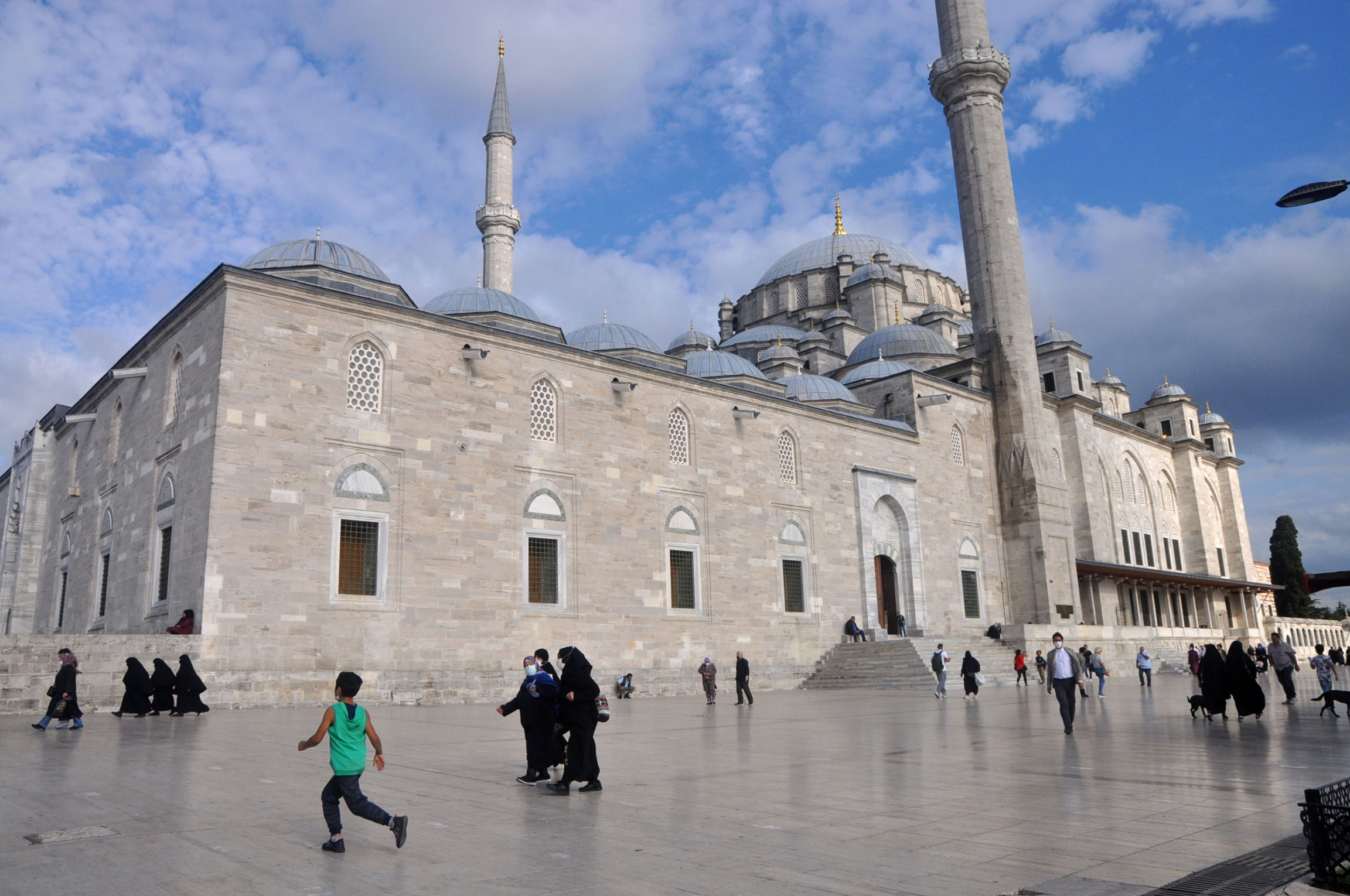 The grounds of the Fatih Mosque, first built in the 15th century, serve as a popular community space for the Syrian community