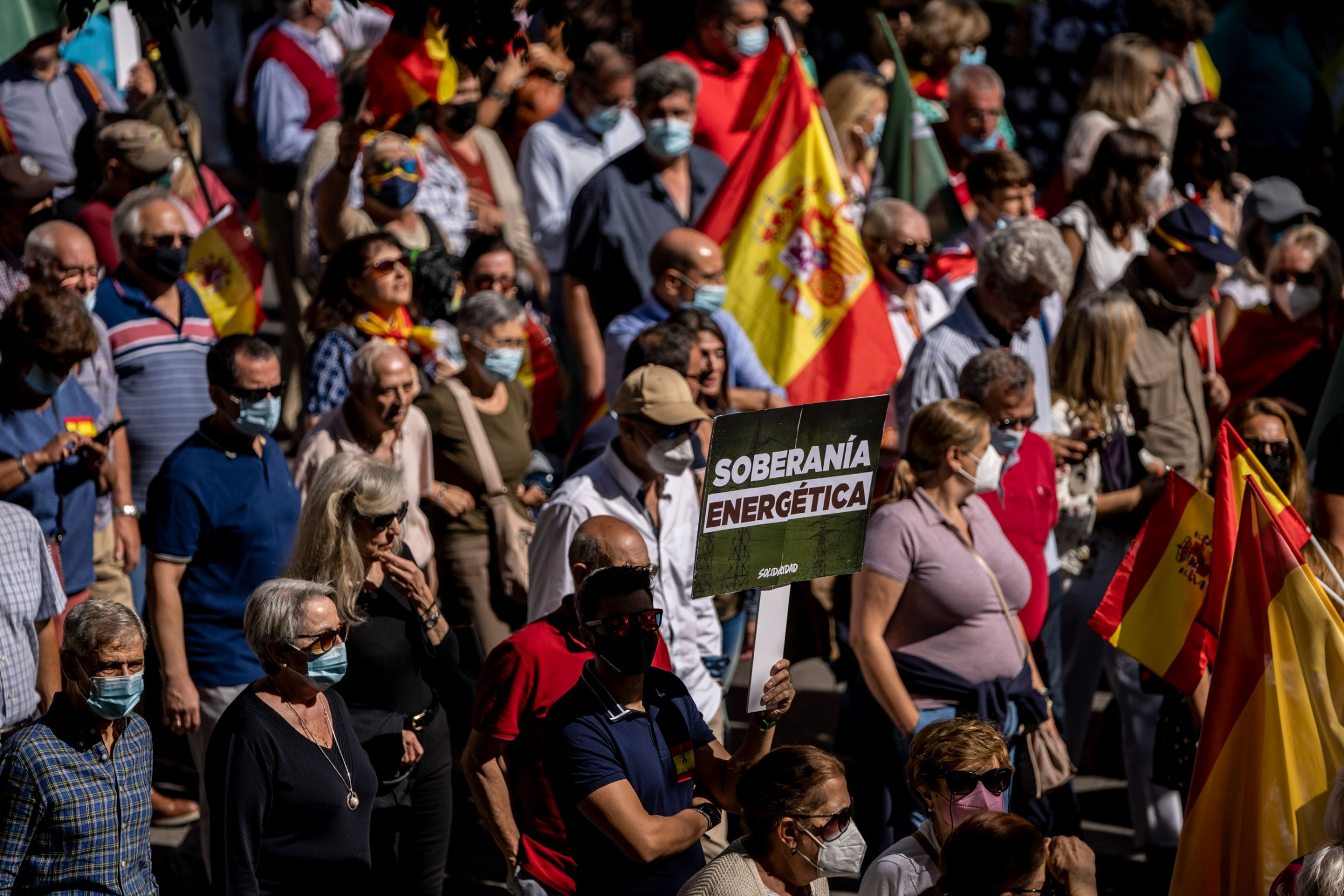 People take part during a protest against the increases in the price of electricity in Madrid, Spain, Sunday, Sept. 19, 2021. Gas and electric prices are spiking in Europe.