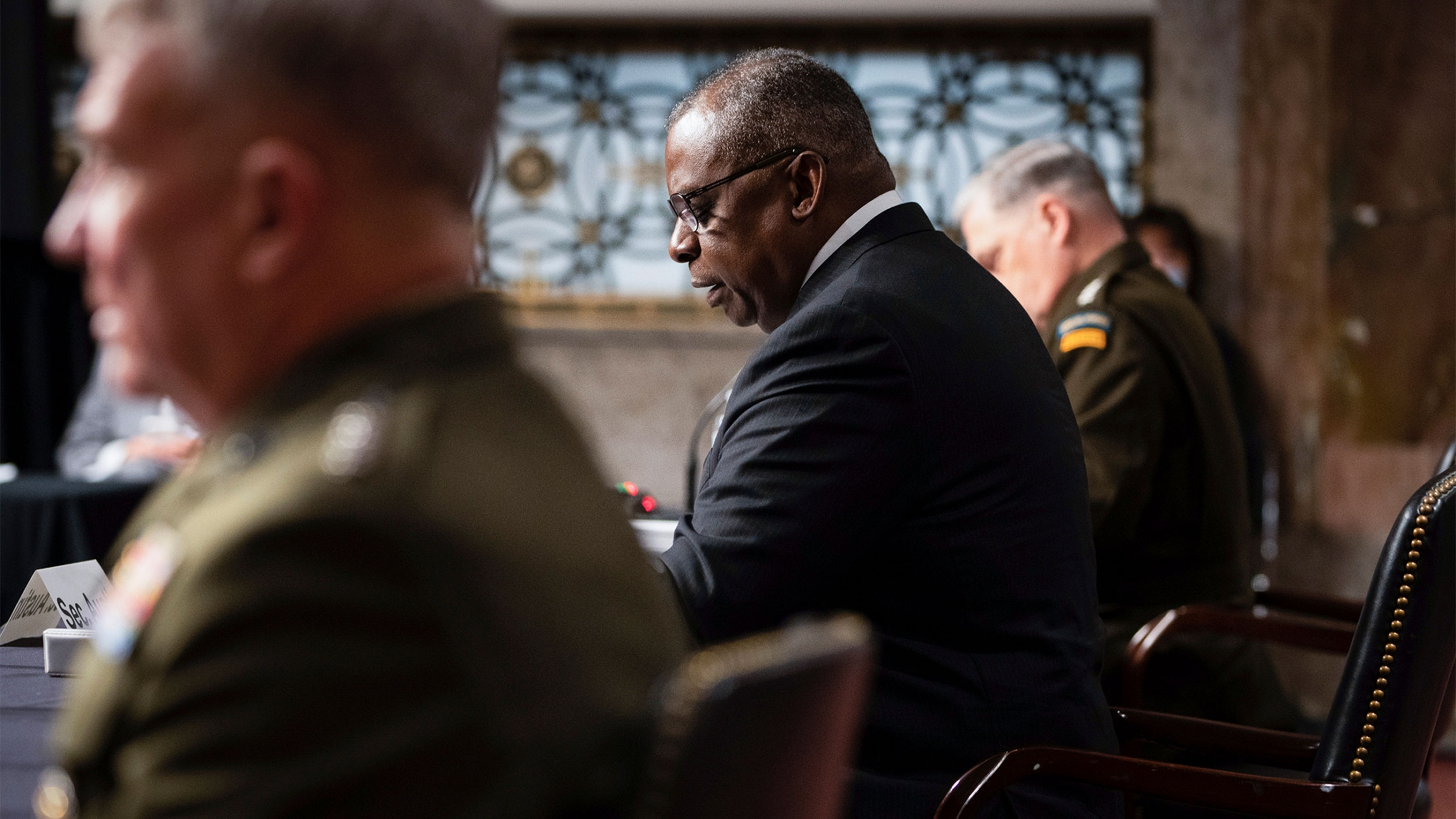 From left, Gen. Kenneth McKenzie, commander of the United States Central Command, Defense Secretary Lloyd Austin, and Chairman of the Joint Chiefs of Staff Gen. Mark Milley testify during a Senate Armed Services Committee hearing on Capitol Hill