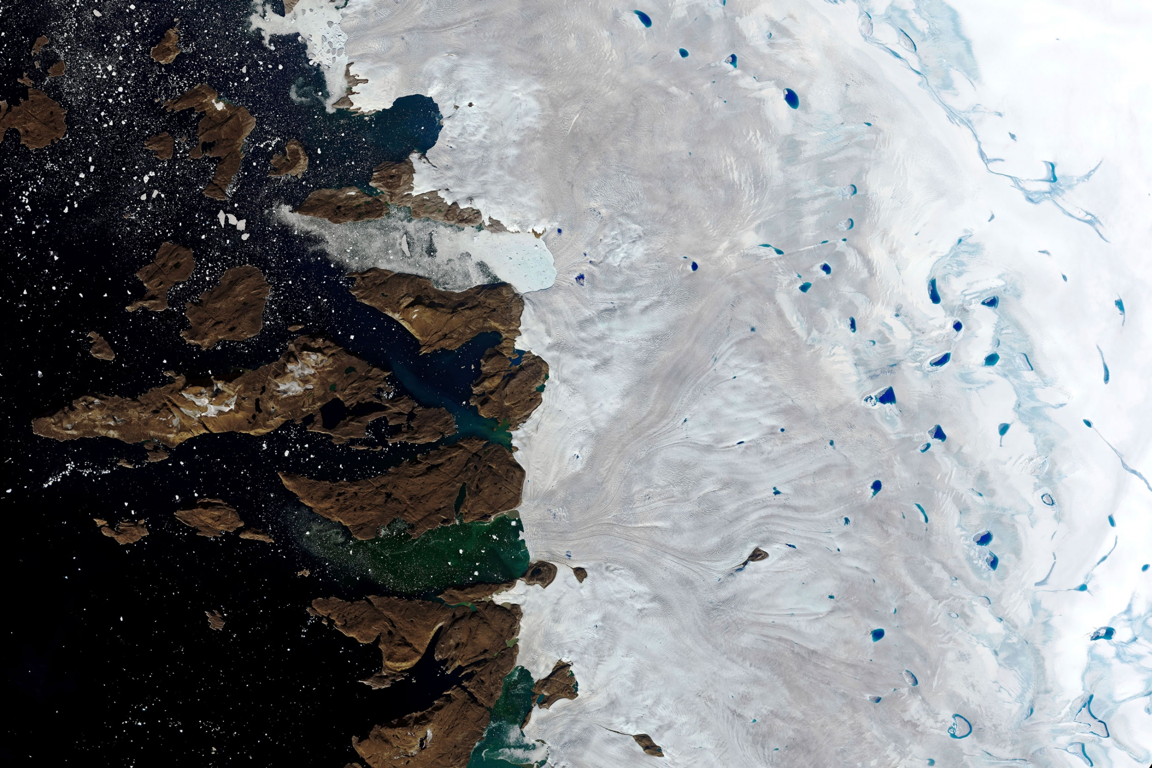 This Monday, July 30, 2019 natural-color image made with the Operational Land Imager (OLI) on the Landsat 8 satellite shows meltwater collecting on the surface of the ice sheet in northwest Greenland near the sheet's edge.