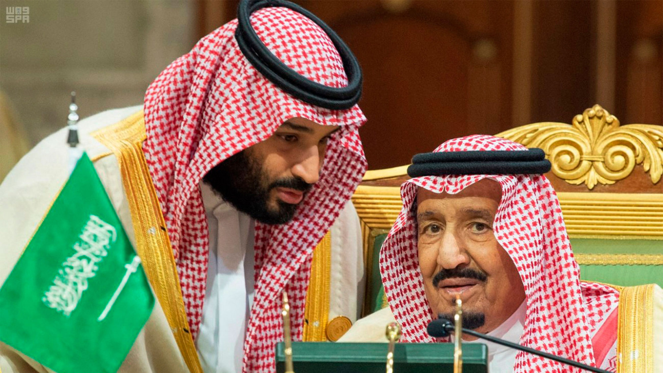In this photo released by the state-run Saudi Press Agency, Saudi Crown Prince Mohamed bin Salman, left, speaks with his father, King Salman, right, at a meeting of the Cooperation Council for the Arab States of the Gulf in Riyadh, Saudi Arabia.