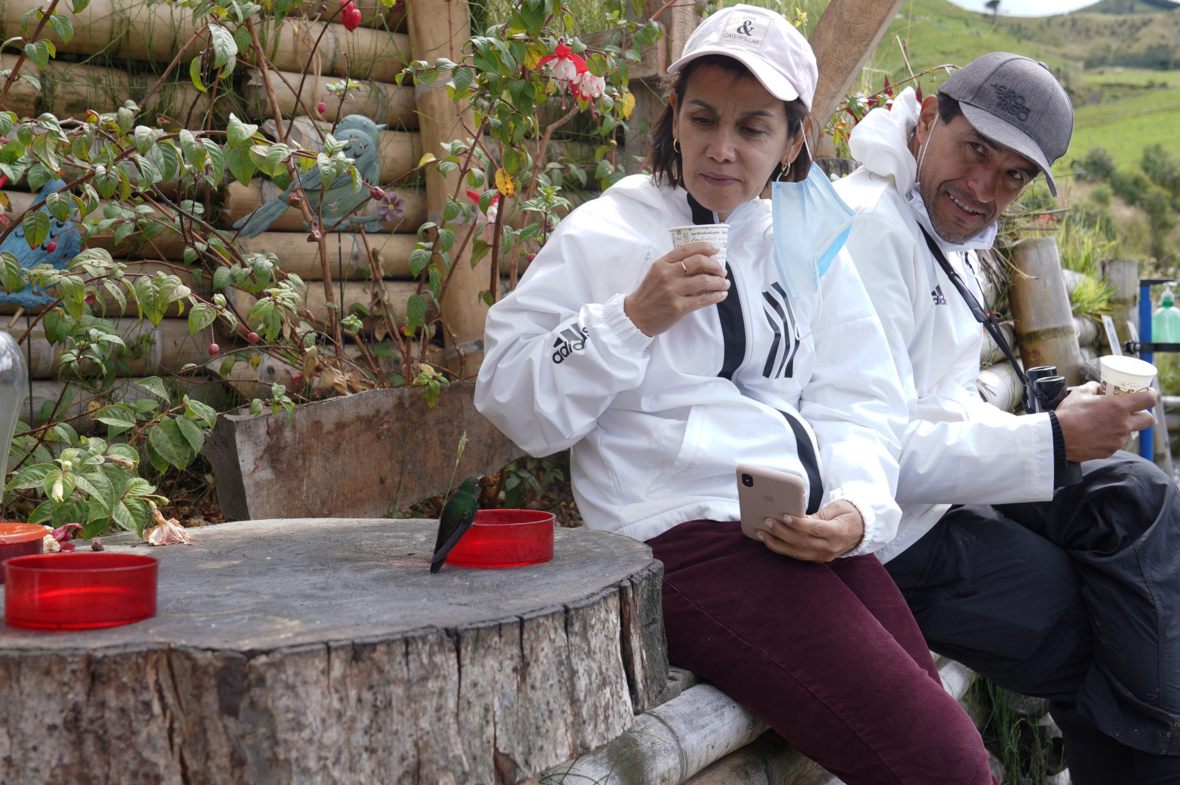 A tourist from Medellin Colombia gets up close with a hummingbird at Hacienda El Bosque.