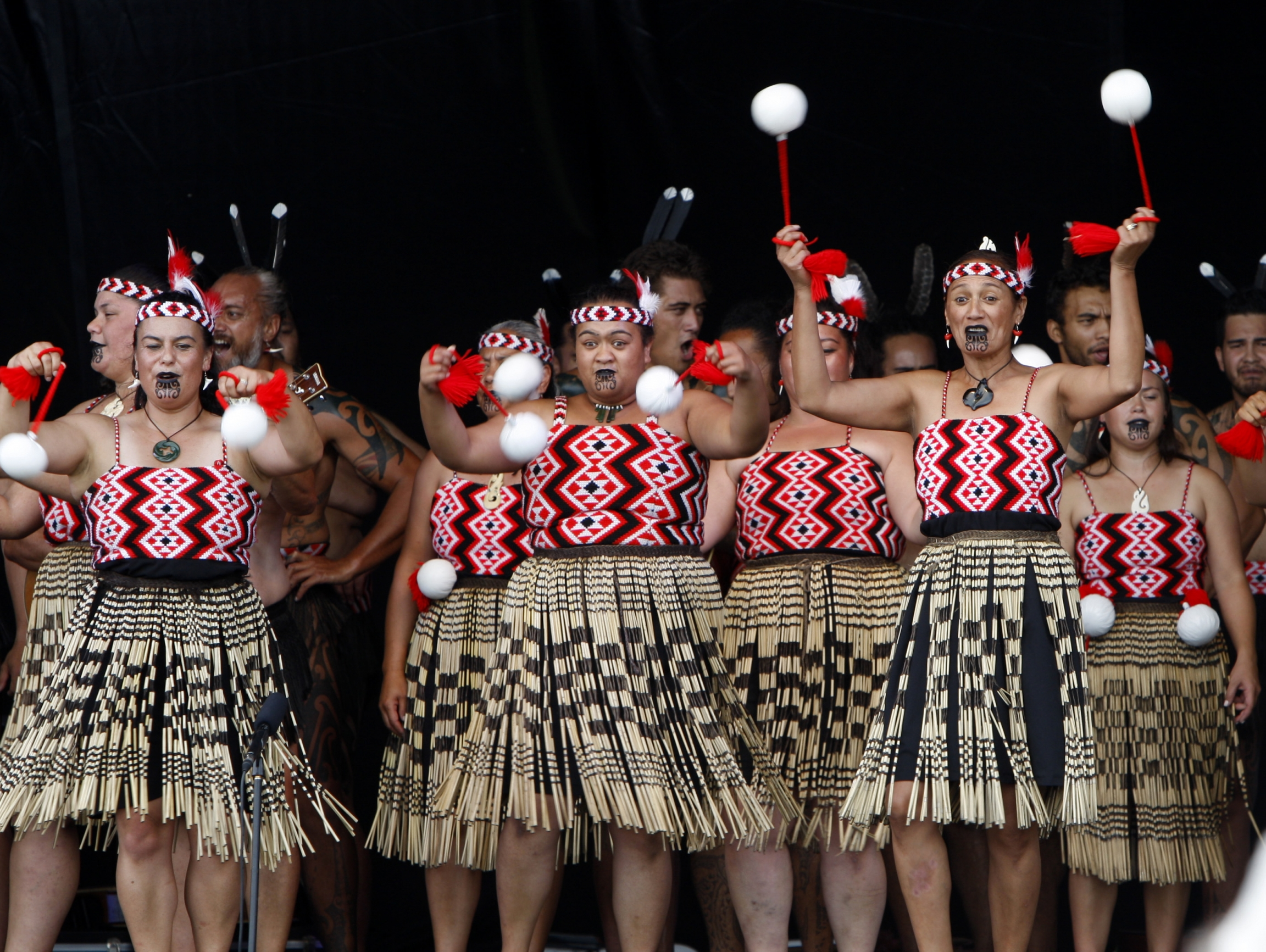 """In this Feb. 6, 2015 photo, dancers twirl white """"poi"""" balls as part of an indigenous Maori performance, in Waitangi, New Zealand, to mark the 175th anniversary of the signing of the country's founding document, the Treaty of Waitangi."""