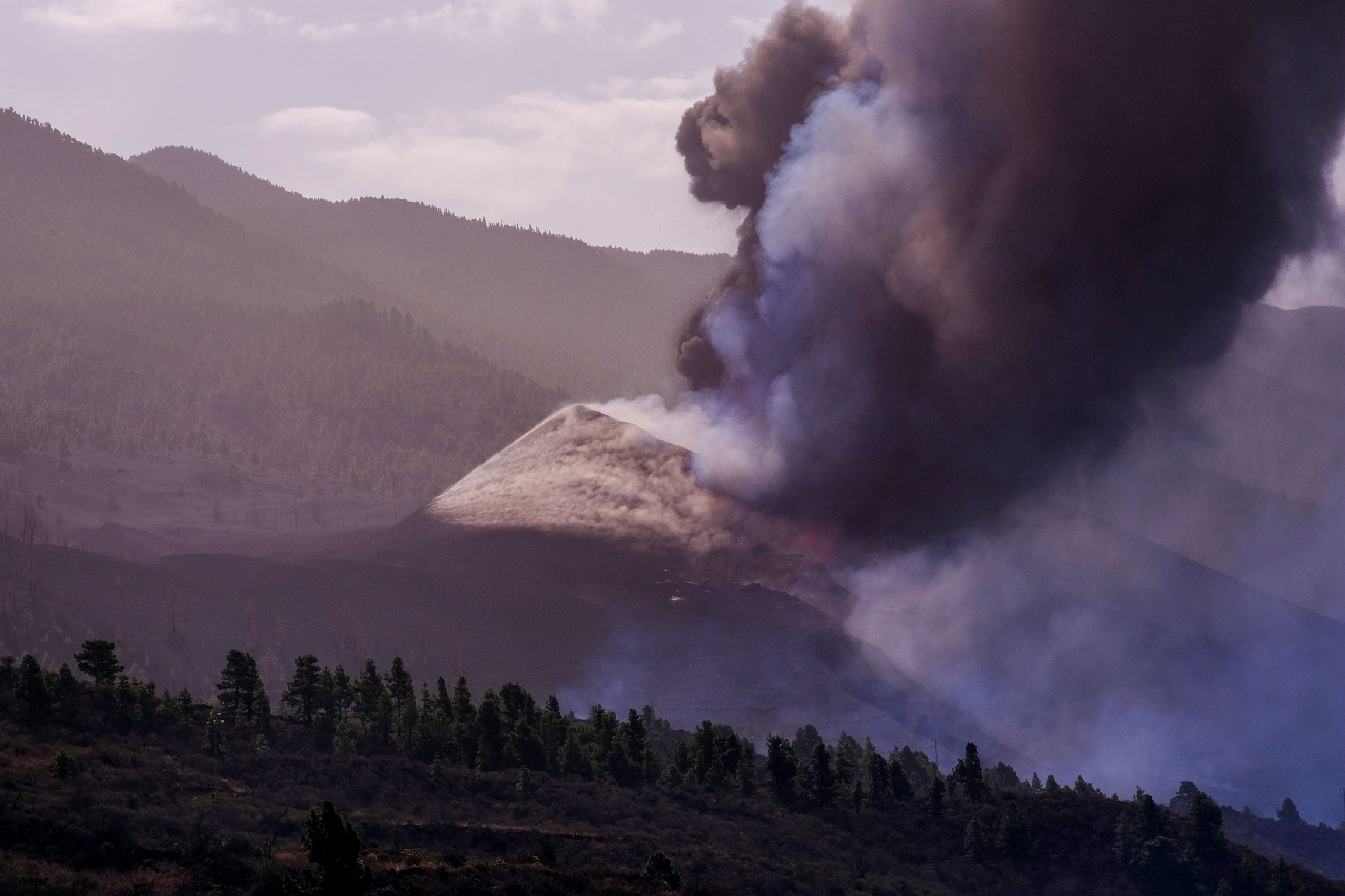 Smoke rises from a volcano on the Canary island of La Palma, Spain, Spain on Friday, Oct. 1, 2021.