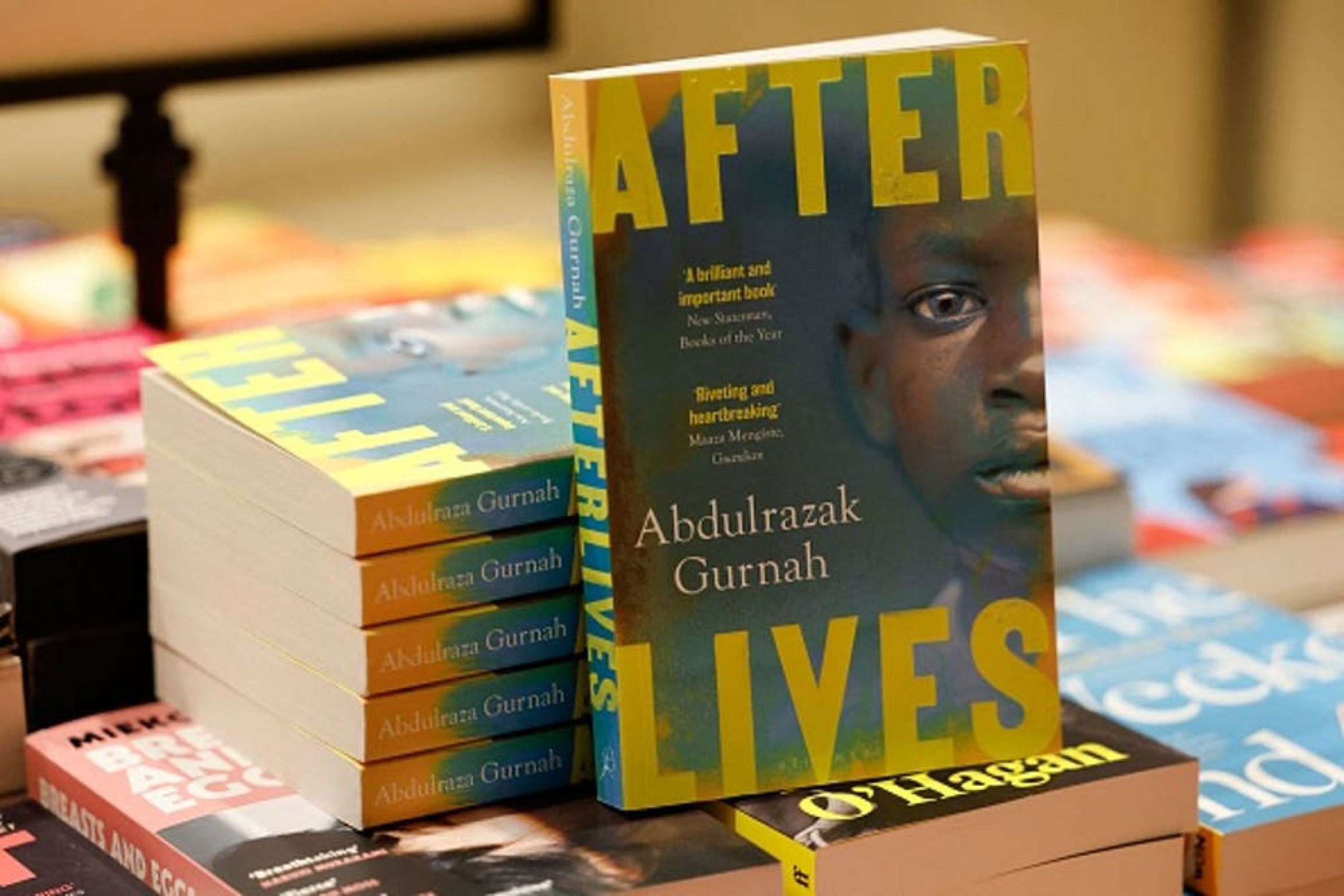 """Copies of """"Afterlives,"""" by novelist Abdulrazak Gurnah, who grew up in Zanzibar, in East Africa."""