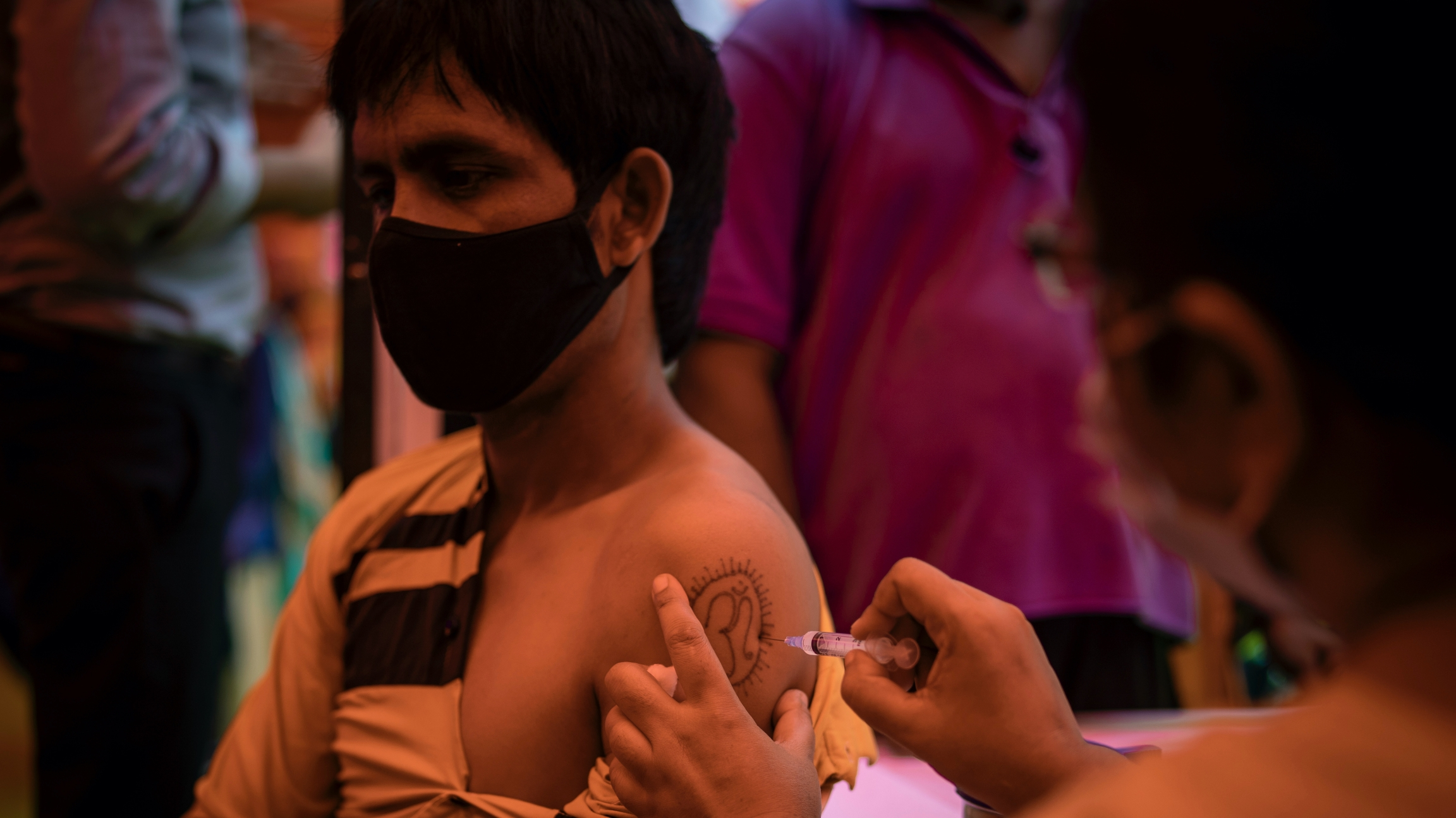 A health worker inoculates a man during a vaccination drive against COVID-19 in Delhi, India, Sept. 29, 2021. India will soon roll out the world's firstDNA vaccine.
