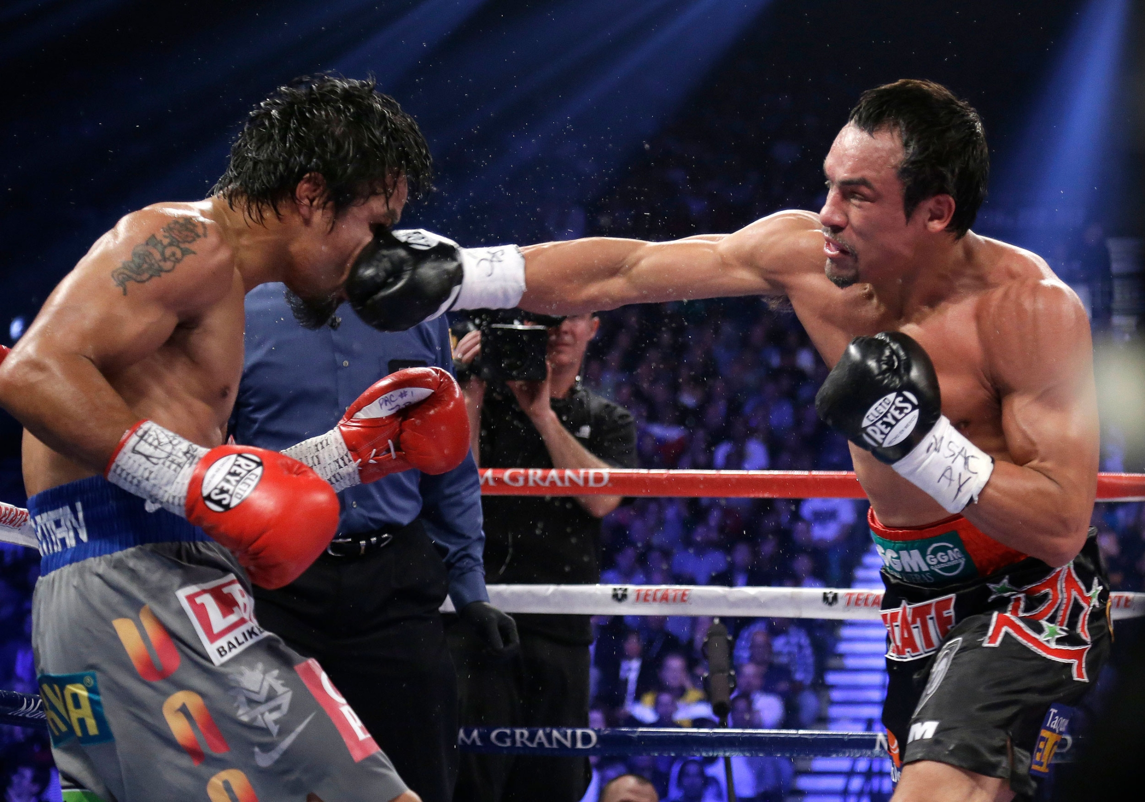 In this Dec. 8, 2012 file photo, Mexico's Juan Manuel Marquez lands a right to the head of Manny Pacquiao, from the Philippines, during their WBO world welterweight fight, in Las Vegas.