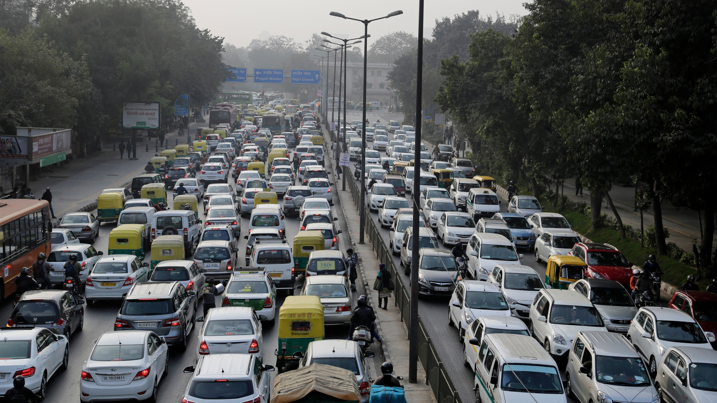 Vehicles move slowly through a traffic intersection after the end of a two-week experiment to reduce the number of cars to fight pollution in in New Delhi, India