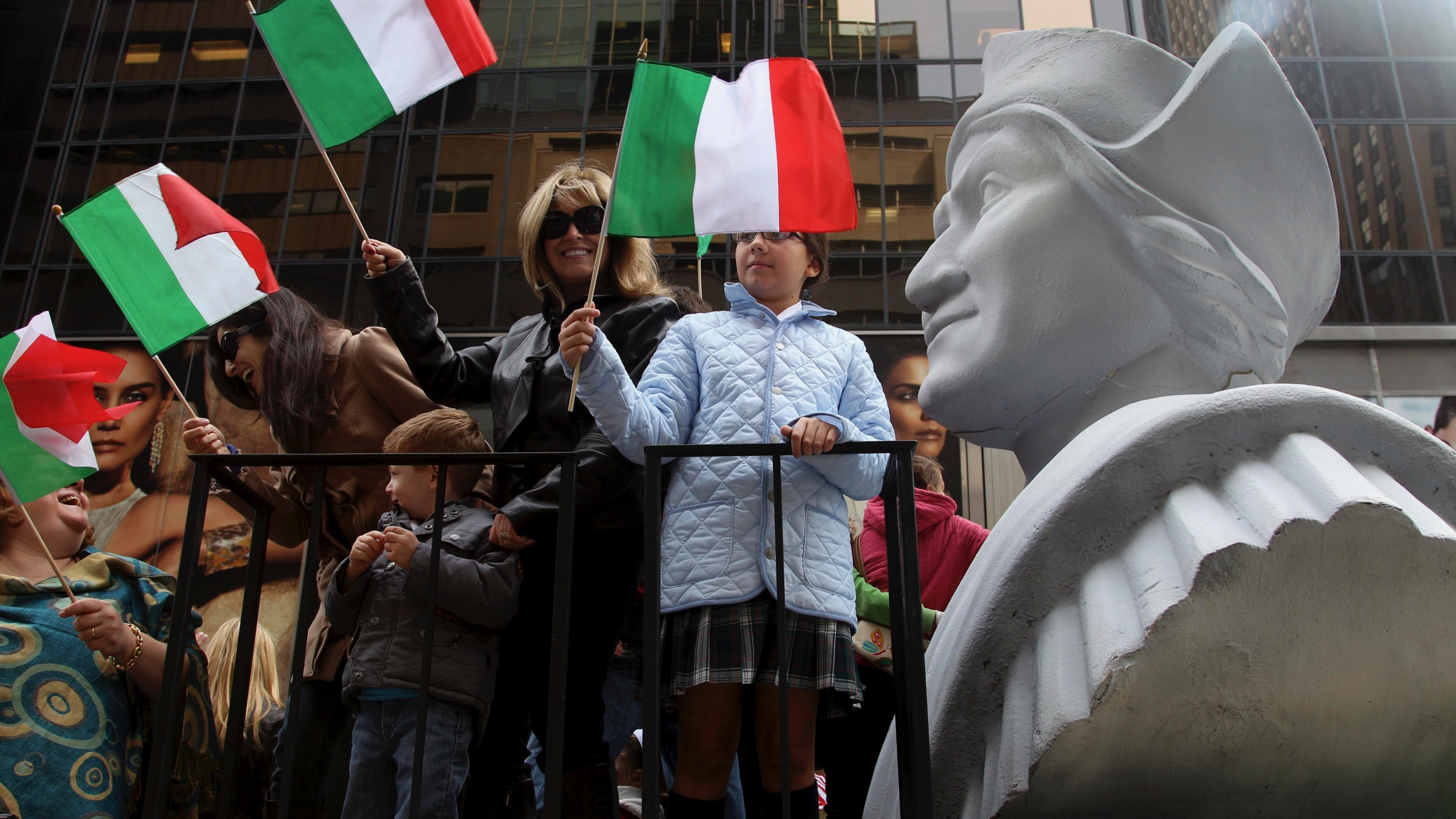 People ride on a float with a large bust of Christopher Columbus during the Columbus Day parade in New York, Oct. 8, 2012. The Oct. 12 federal holiday dedicated to Christopher Columbus continues to divide those who view the explorer as a representative of