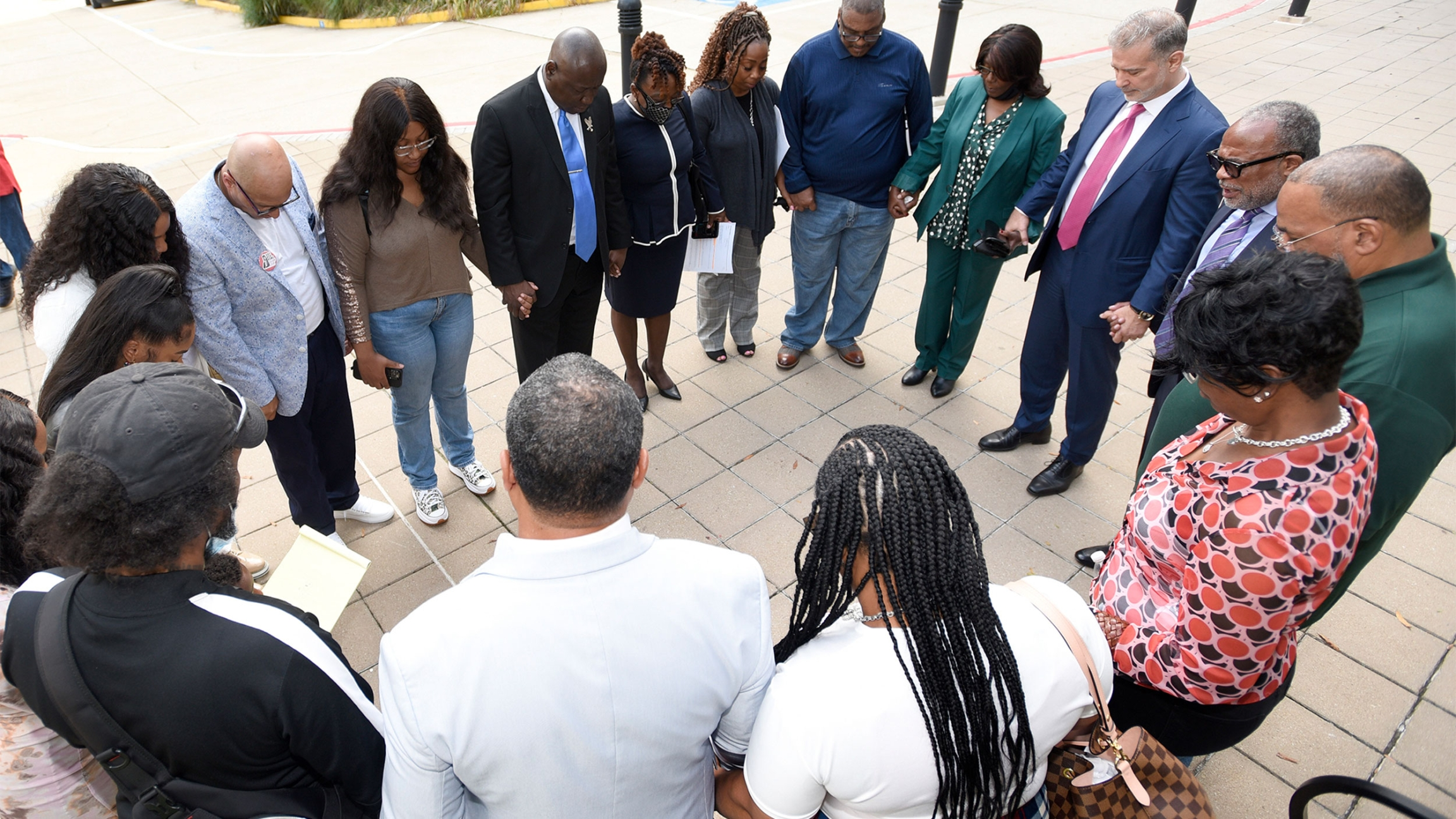 Descendants of Henrietta Lacks, whose cells, known as HeLa cells, have been used in medical research without her permission, say a prayer with attorneys outside the federal courthouse in Baltimore