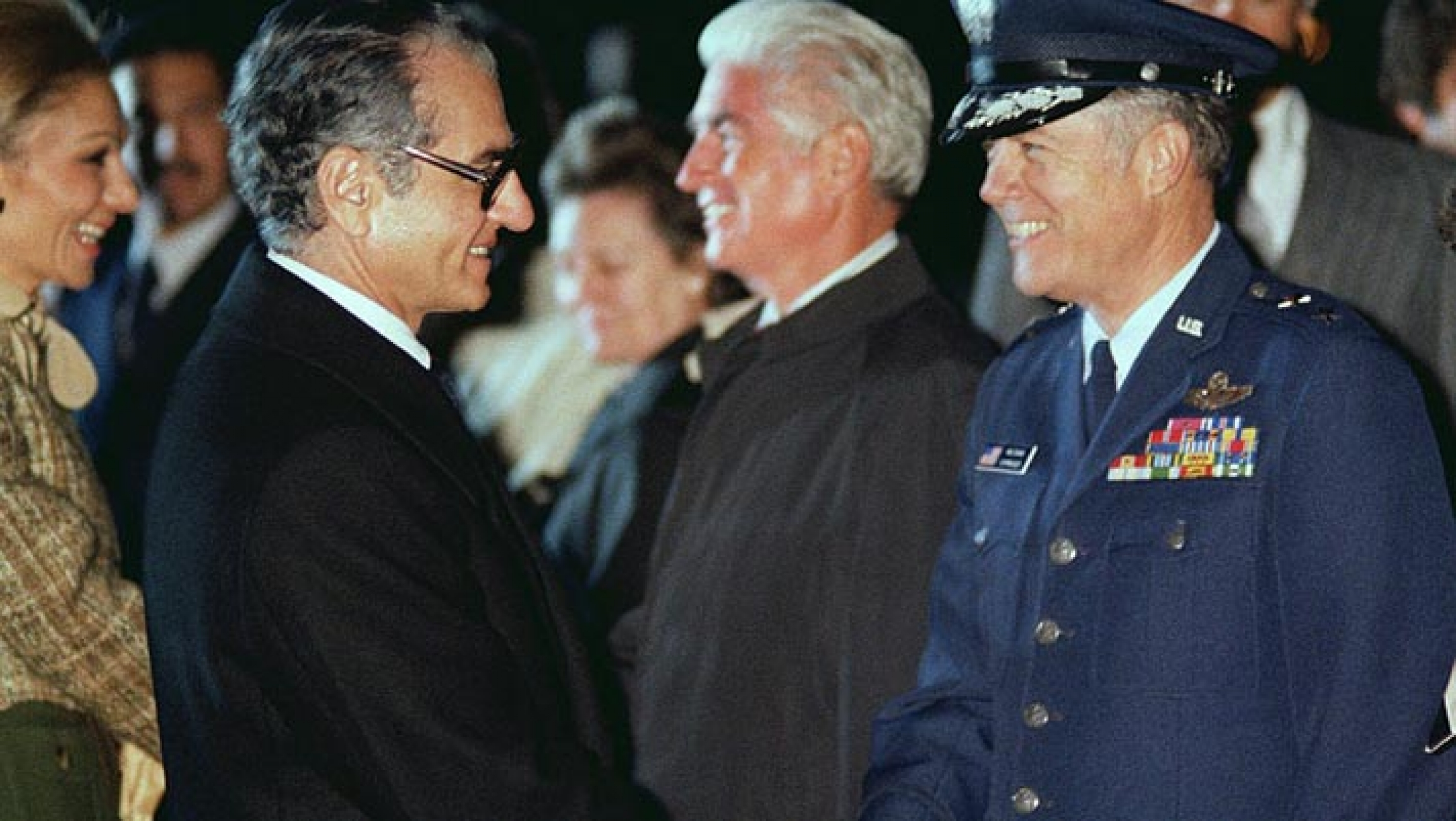 Mohammed Reza Pahlavi, Shah of Iran, shakes hands with a US Air Force general officer prior to his departure from the United States.