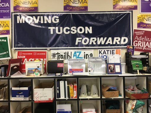 Shelf with various campaign items, posters