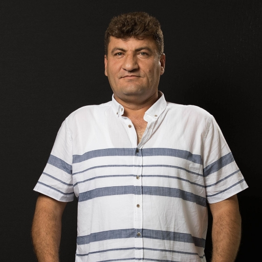 Raed Fares in front of a black background