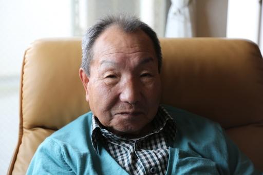 a closeup of Iwao Hakamada's face