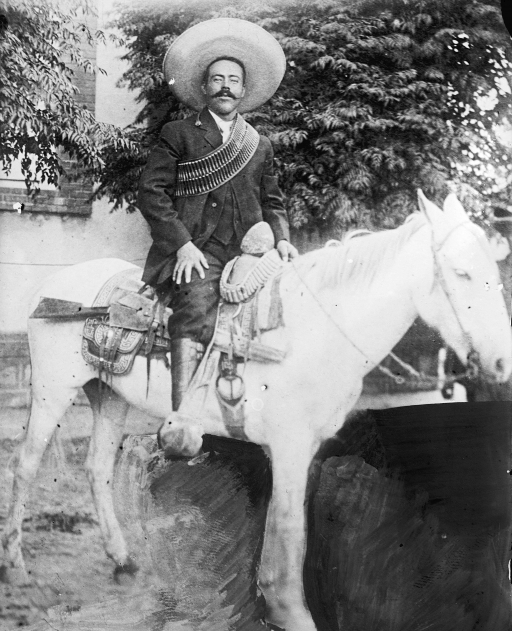 a black and white photograph of Pancho Villa on a white horse