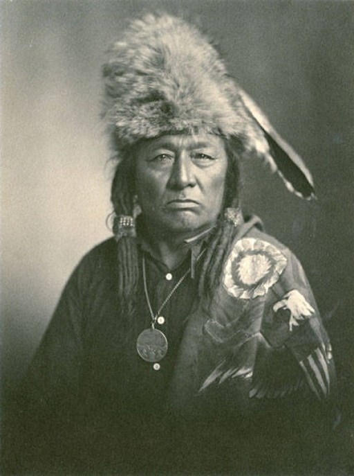 An Indigenous Cree chief sits for a portrait