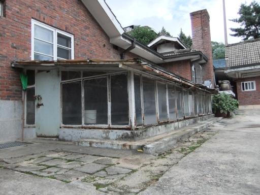 A dilapidated brick building