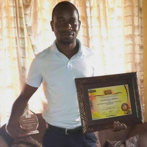 Young Zimbabwe man holds certificates of achievement
