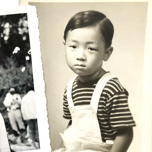An old photo of a child posing for the camera