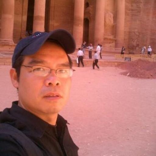 Man taking selfie with old image behind him