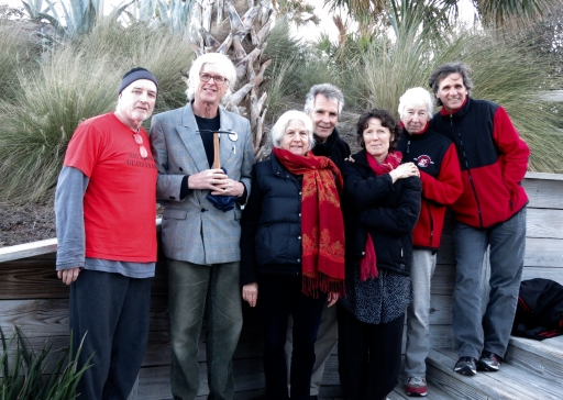 Plowshares 7 activist group poses for photograph wearing the colors red and black.