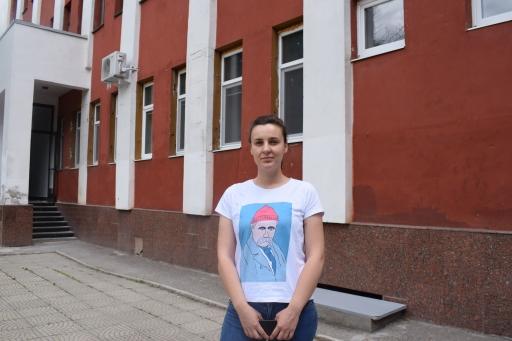 A woman stands near an office