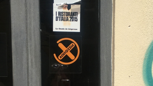 A restaurant displays the Addiopizzo sign on its doors to show it doesn't support the Mafia.