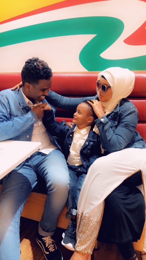 A Somali refugee family sitting in Nairobi, Kenya.