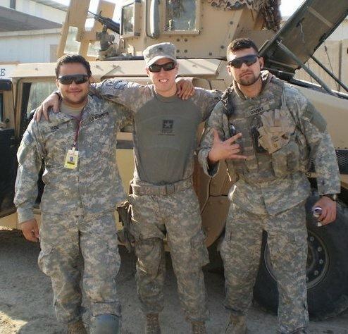 Three men in military uniforms arm in arm