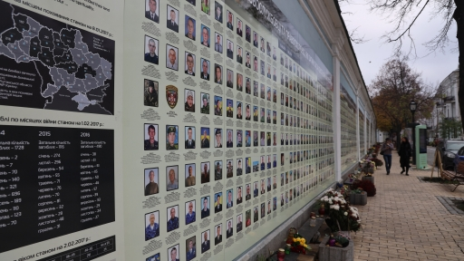 Circumscribing the St. Michael's monastery grounds in Kyiv, Ukraine, is a wall of portraits of soldiers.