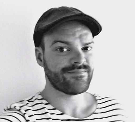 A black and white portrait of reporter Steven Grattan