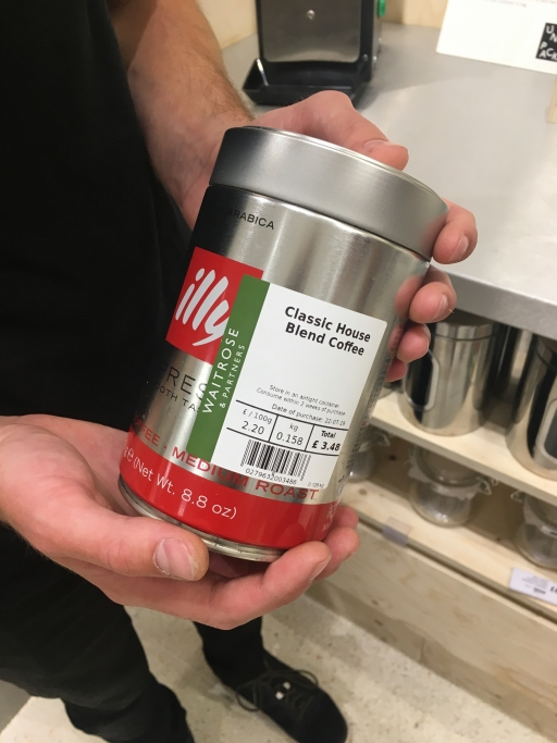 A Waitrosecustomer shows off the container he brought to fill with coffee.