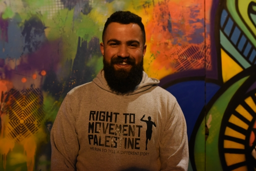 A portrait of Mahmoud Lafi, leader of Right to Movement, wears a grey sweatshirt