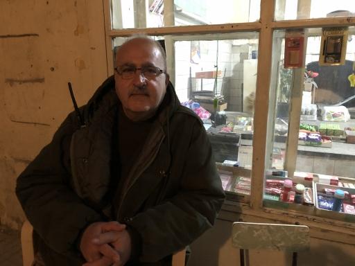 Baruyr Solakian sits outside a shop in Beirut's Bourj al-Hammoud neighborhood.