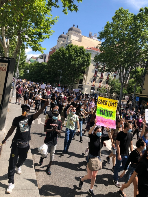 Protesters marched on June 7 in Madrid, Spain, holding signs with anti-racist slogans.