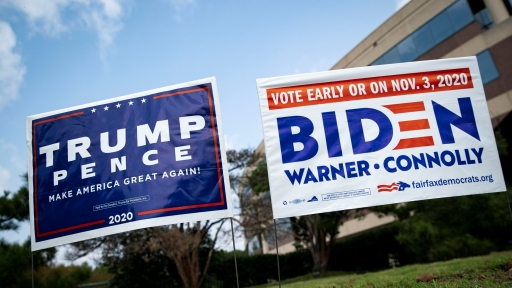Yard signs supporting USPresident Donald Trump and Democratic USpresidential nominee and former Vice President Joe Biden are seen outside of an early voting site at the Fairfax County Government Center in Fairfax, Virginia, Sept.18, 2020.