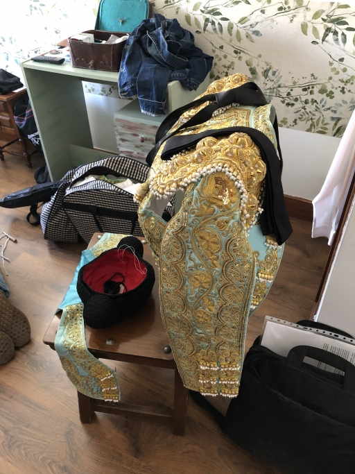 Leandro Gutierrez's ornate bullfighting outfit draped on a chair.