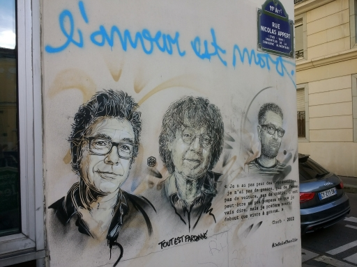 A mural depicts several of the Charlie Hebdo journalists who lost their lives in the attacks on their offices in Paris in January 2015.