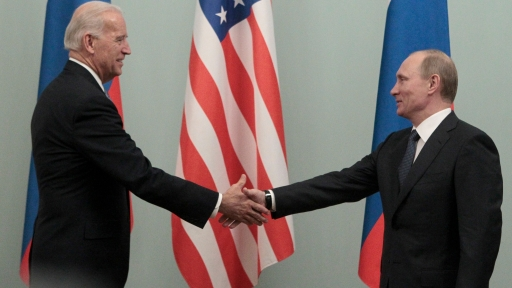 Then-Prime Minister Vladimir Putin shakes hands with Biden on the second day of his official visit to meet with top officials in the Russian capital in Moscow, March 10, 2011.