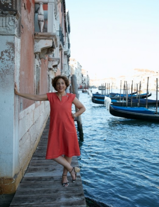 Jane Da Mosto, seen on the edge of a Venetian canal, is not complaining about the lower number of tourists visiting her hometown these days.
