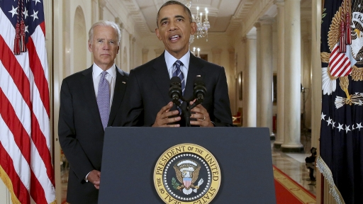 Former US President Barack Obama delivers a statement after a nuclear deal was reached between Iran and six major world powers, beside former Vice President Joe Biden, in the East Room of the White House in Washington, July 14, 2015.