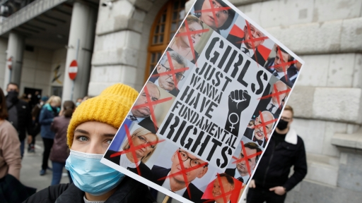 A woman takes part in the protest against the high court ruling, in Warsaw, Poland.