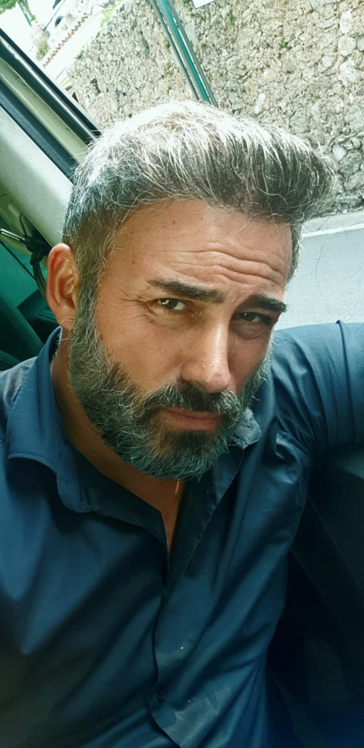 Naples taxi driver Ciro la Motta, with salt-and-pepper beard.
