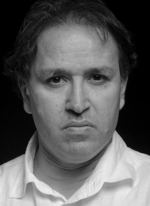 Black and white portait of Khaled Mattawa, a Libyan American poet.