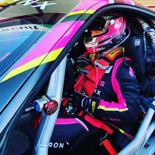 Michelle Gatting sits behind the wheel of her race car.