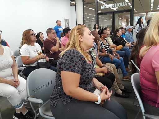 Group of Cuban Americans sitting on chairs at a meeting