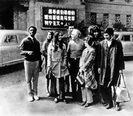 A black and white blurry photo of the US pingpong team in China