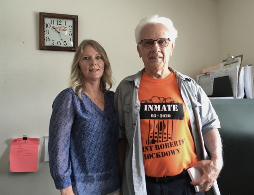 Ali Hayton, owner of Point Roberts International Marketplace, poses at her office alongside Brian Calder, president of the Point Roberts Chamber of Commerce.