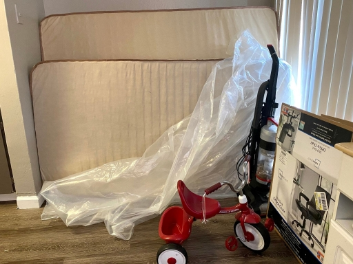 Donated mattress and a tricycle are among the items slowly arriving at a newly arrived Afghan family's apartment in Sacramento, California.