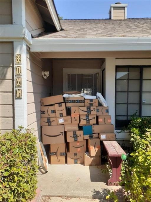 Boxes arrive at the door of a World Relief Sacramento employee. Donations are arriving quickly to the refugee resettlement agency. The boxes are filled with everything from kitchen supplies to bedding, items needed to help furnish newly arrived Afghan ref